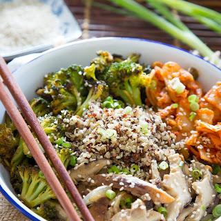 Quinoa Kimchi Bowl with Miso Mushrooms and Crispy Broccoli.