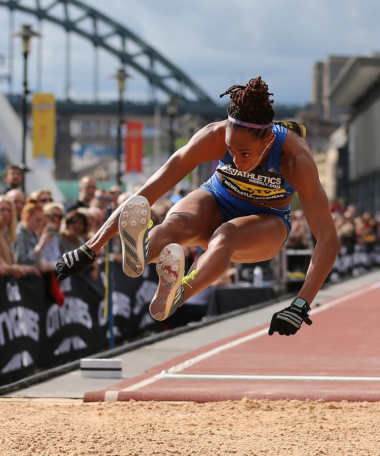 Long jumper flying.  by Ron Russell - Sports & Fitness Other Sports ( flying, sand, shara, proctor, long jump, lady, tyne bridge )