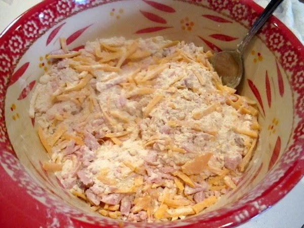 Stir in the ham, mustard, pepper and cheese.