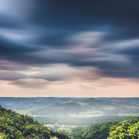 Hill in fog by Andrej Folo - Landscapes Mountains & Hills ( hills, colorful, leaf, landscape, leafs, village, movement, cloudy, long exposure, clouds, istra, hill, moving, green, colors, croatia, cloudscape, forest, motovun, morning, foggy, istria, fog, sunrise, town, little town, longexposure )