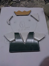 Photo: Using my wet saw, I cut the pieces to size, using the paper as my blueprint.