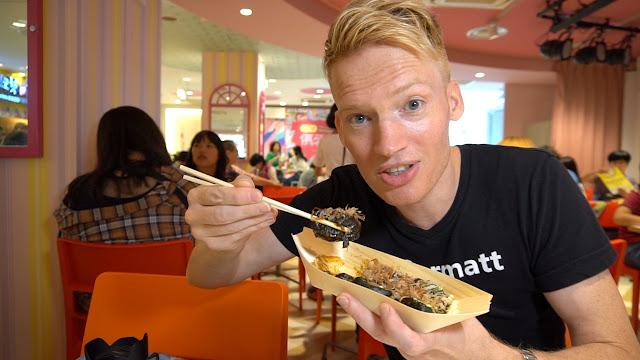 eating Black Takoyaki at Solado, Harajuku in Tokyo, Tokyo, Japan