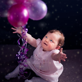 Catching dreams by Laura Prieto - Babies & Children Babies ( birthday, girl, purple, pink, baby, party, balloon, cute, eyes )