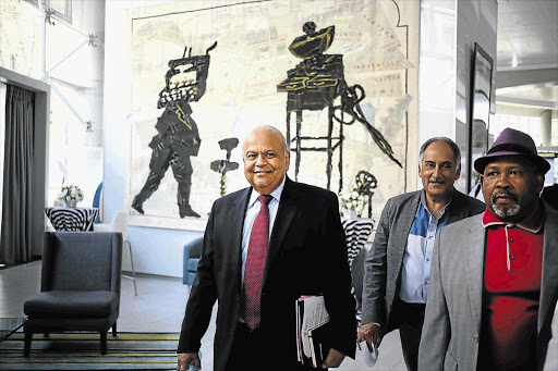 ROAD WARRIORS: Finance Minister Pravin Gordhan briefed the media yesterday on his investor roadshow to London and the US last week. In Gordhan's overseas team were Cas Coovadia, MD of the Banking Council of SA, centre, and Telkom chairman Jabu Mabuza, right