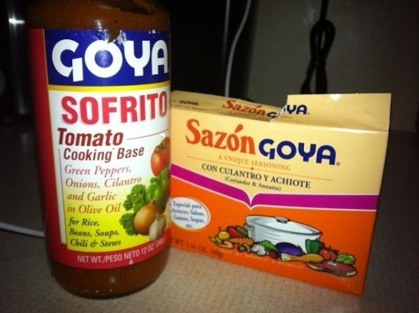 Add onions, and cook 5 minutes more. Stir in tomato sauce, olives, Sofrito, Sazon,...