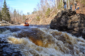 Photo: Duluth resident Andy Scheidel makes his way to one of the last rapids on the Lester River Race. At the bottom of this rapid, more than 50 spectators lined the shore and up the cliffs, cheering each kayaker along as they made their way down the course.