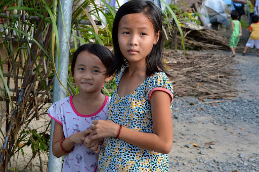 girls-in-vietnam.jpg - Two girls outside a small village along the Mekong River.