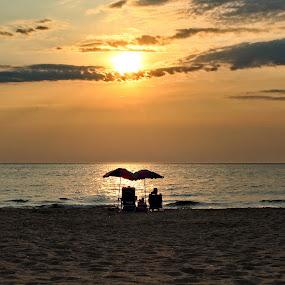 Enjoying the View by Jennifer Smusz - Landscapes Sunsets & Sunrises ( #lakemichigan, #puremichigan, #peace, #sunset #lakeview #lake #beach, #serenity, #michigan, #beachumbrellas, #bliss, #couple )