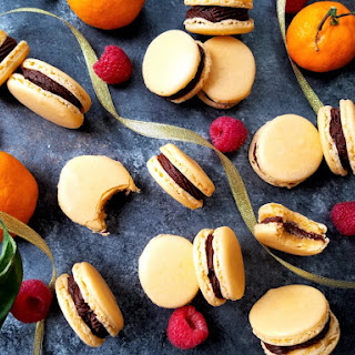 Orange French Macarons with Chocolate Raspberry Buttercream.