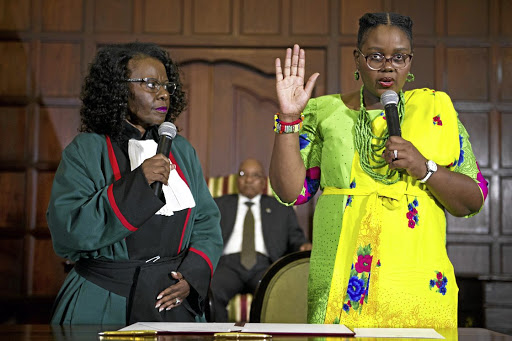 On board: The swearing in of Energy Minister Mmamoloko Kubayi, right, in Parliament in March. She says the new agreements will be signed with nuclear vendors but she does not want to find herself in court every day. Picture: GCIS