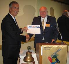 Photo: President Joe Johnson receiving the prestigious Rotary International President's Award