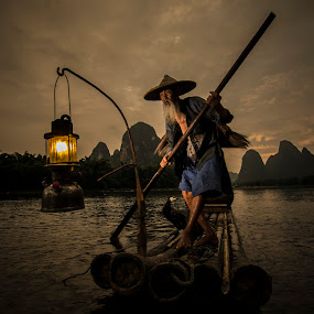 Guilin's Fisherman by Fuad Rahim Asman - People Portraits of Men ( bird, raft, guilin, fisherman, river )