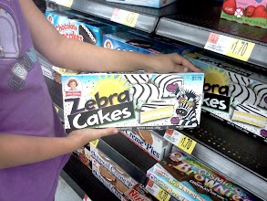 Photo: My daughter, Olivia, loves these Zebra Cakes so I let her get a box to share with her siblings. She modeled the box so nicely.