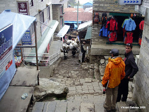 Photo: David and Vik await the oncoming traffic rush in 'downtown' Namche.