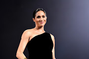 Meghan, Duchess of Sussex on stage during The Fashion Awards 2018 In Partnership With Swarovski at Royal Albert Hall on December 10, 2018 in London, England.