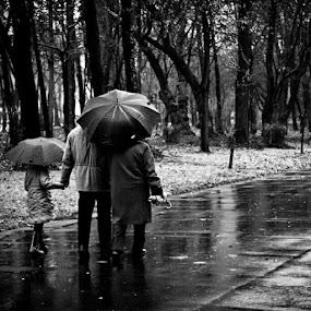 Some walk, some run #streetphotography  #rain #b&w #monochrome by Alex Cruceru - Instagram & Mobile Instagram
