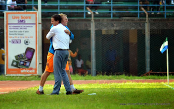 Photo: Head Coach Johnny McKinstry and Assistant Tom Harris celebrate the Leone Stars going 1-nil ahead [Leone Stars v Seychelles, Freetown, 19 July 2014 (Pic: Darren McKinstry)]
