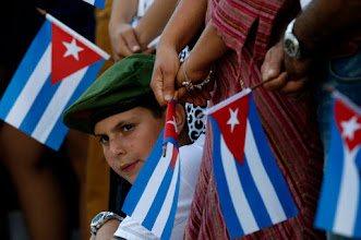 Photo: A boy attends a ceremony to mark the 54th anniversary of the Cuban Revolution in Camaguey, Cuba, Thursday, July 26, 2007. Castro told tens of thousands of loyalists that the country suffered a serious blow when his brother Fidel fell ill a year ago, but that the chaos that the U.S. had long predicted never materialized. (AP Photo/Javier Galeano)