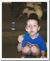 Nicholas blowing bubbles