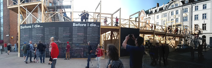 Photo: Aarhus Festival with big public chalkboard and elevated walkway/viewpoint.