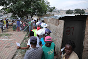Residents queued to and from the collection of food parcels.