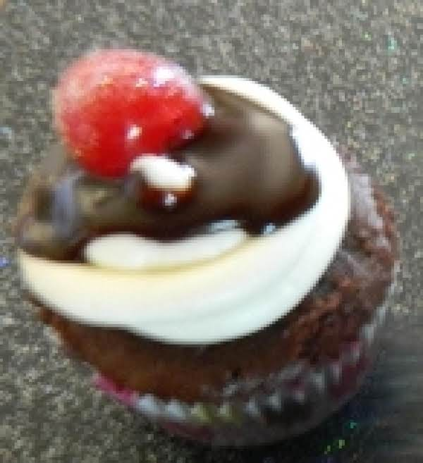 Hot Fudge Sundae Cupcake With Marshmallow Buttercream Frosting, Chocolate Ganache, And A Blinged-up Cherry On Tip!