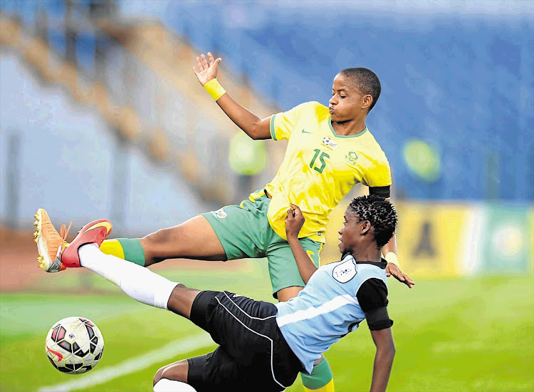 Banyana's Refiloe Jane, in yellow shirt, and Botswana international Kitso Sheba go at it boots and all in the second leg of their All Africa Games qualifier.