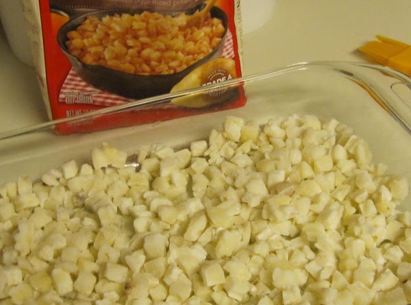 Thaw frozen hash browns in microwave then spread on bottom of baking dish. ...