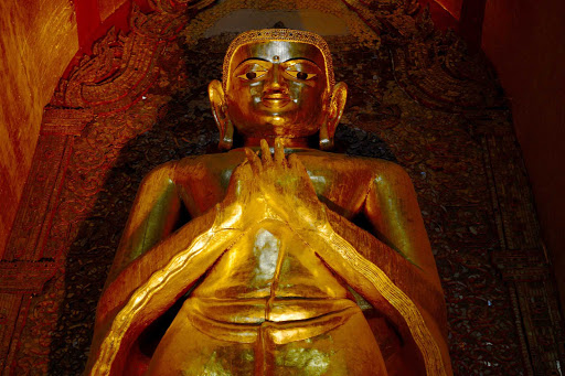 myanmar-buddha-statue.jpg - Golden statues and gold leaf decorations adorning temples and pagodas, built to honor the Buddha, can be seen throughout Myanmar.