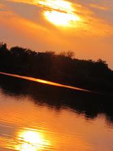 Photo: Orange sunset over a lake in Eastwood Park, Dayton, Ohio.