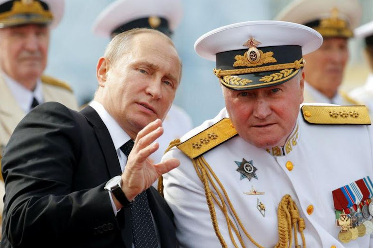 Russian President Vladimir Putin speaks with Commander-in-Chief of the Russian Navy Admiral Vladimir Korolev. Picture: REUTERS