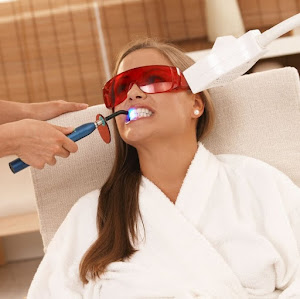 Lady receiving teeth whitening treatment