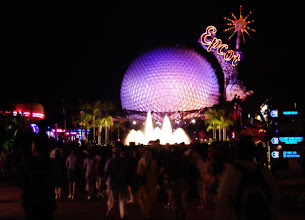 "Photo: On a trip to Disney in the spring of 2004, my friends and I spent one of many days in the parks. Today we were in Epcot. The fireworks had finished and the masses made the push towards the exit. As we were walking out, I had to take at least one shot of Spaceship Earth. I know it's not perfect, and actually that's kind of what I'm going for. I think I made the same mistake most ""tourists"" make when taking a picture. Now, I did try to fix it some in post processing with Cropping and Straitening, and adding a bit of ""Lomo"" effect in Photoshop, but there's only so much you can do when the picture isn't a good composition to begin with.  So what improvements would you do to get a better version of this shot? Where would you stand? Would you zoom? And try to take into account you're not able to stand around for 30 minutes for the crowds to thin out.  [download a full version http://flic.kr/p/bEfz83] Tags: #WDWPhotoFriday #DisneyPics #WaltDisneyWorld #Epcot #SpaceshipEarth"