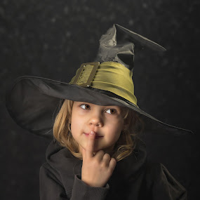 Cute little witch by Mario Toth - Babies & Children Child Portraits ( studio, expression, person, holding, little, caucasian, hat, halloween, kid, hand, child, girl, happy, witch, dark, childhood, celebrate, black, isolated, fun, young, portrait, human, holiday, magic, female, dress, background, costume, small,  )