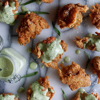 Crab Fritters with Green Goddess Dressing.