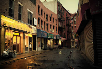 """Photo: """"Seduction..""""  New York Photography: Doyers Street, Chinatown in the rain.  When the sky seduces the city with its tears of happiness, the streets swoon illuminated by the glow of nearby lights.  Broken-hearted alleys fill up: lovers with empty recesses in their hearts soak in the warm afterglow of what the sky has wrought.    You can view this post if you wish at my site here:  http://nythroughthelens.com/post/16359905959/rainy-doyers-street-in-chinatown-new-york    Tags: #photography #writing #poetry #prose #chinatown #newyorkcity #nyc #manhattan #rain #moody #gloomy #city #urban"""