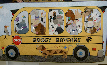 Photo: The doggies are being bused to their Daycare, Groomers or Veterinarians. The Dachshund is running alongside the bus with his bone in his mouth not to be left out of the fun. Fin your favorite pet among this howling crew!