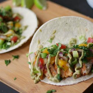Spicy Fish Tacos with Mango Salsa and Avocado Cilantro Crema Recipe