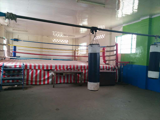MAKEOVER: The front view of the Pumwani Social Hall. Below, a boxer practises at the hall, in Majengo