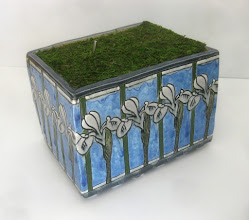 """Photo: """"Planter--closed"""" A porcelain planter with underglaze and glaze. Fake moss on top presents the viewer with a lever switch, which when activated..."""