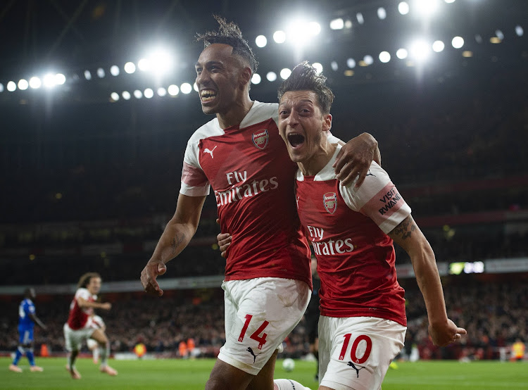 a49fbdf56 Pierre-Emerick Aubamayang of Arsenal celebrates with Mesut Ozil after  scoring Arsenal s third goal during