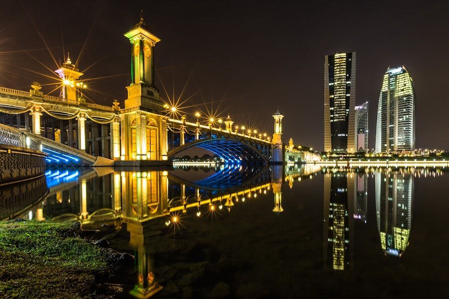 Nightscape in Taman Seri Empangan, Putrajaya by Jacky Ang - Buildings & Architecture Bridges & Suspended Structures ( lights, reflection, lake, seri gemilang bridge. high rise building, night sky )