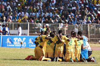 Photo: Coach McKinstry & the Amavubi take a moment together before the penalty shoot-out [Rwanda vs Sudan, CECAFA 2015, Semi final, 3 Dec 2015 in Addis Ababa, Ethiopia.  Photo © Darren McKinstry 2015, www.XtraTimeSports.net]