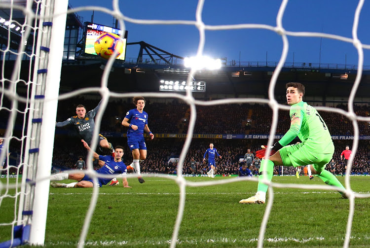 Jamie Vardy of Leicester City scores the game's only goal as Chelsea goalkeeper Kepa Arrizabalaga looks on during the Premier League match at Stamford Bridge on Saturday.