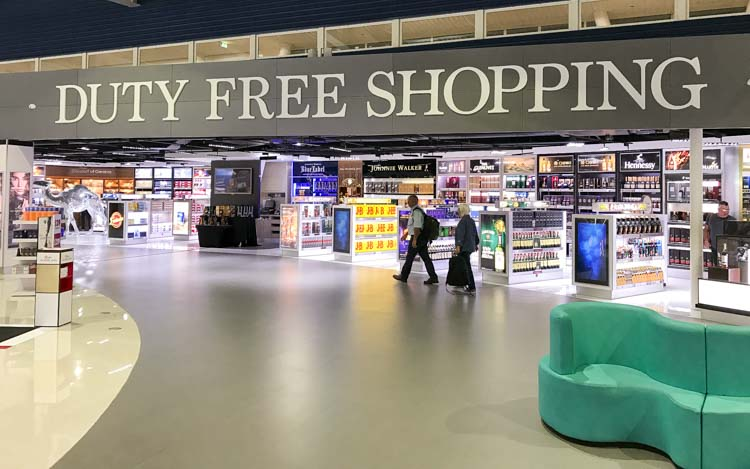 Duty-free shopping at Princess Juliana Internatonal Airport in St. Maarten. Here's our guide on how to find bargains when traveling abroad.