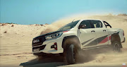 The R707,400 Toyota Hilux GR-Sport roars around a Cape Town sand mine in the banned advert.