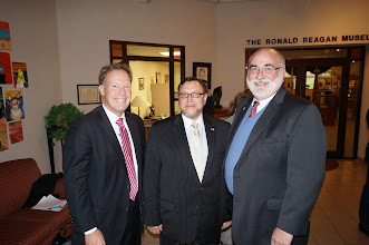 Photo: Mike Mangold, Consul General of Ukraine Andriy Pravednyk, and President Dave Arnold