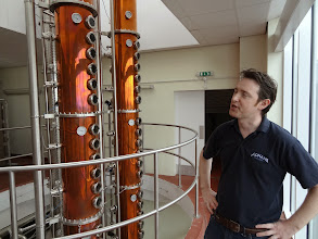 Photo: Adnams brewer Fergus Fitzgerald discusses the brewery's distilling area.