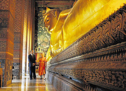 US president Barack Obama visits the Temple of Reclining Buddha at the Wat Pho Royal Monastery in Bangkok, Thailand, yesterday as part of his three-country Asian tour. This is his first international tour since his re-election on November 7, presumably to show he is serious about shifting the US' strategic focus towards the east