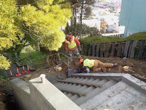 Photo: San Francisco Department of Public Works (DPW) employees smoothing newly-poured concrete on Hidden Garden Steps (16th Avenue, between Kirkham & Lawton streets, in San Francisco's Inner Sunset District); latest work--replacing damaged flight of steps--was done on March 8, 2013. For more information about the Hidden Garden Steps project, please visit http://hiddengardensteps.org and/or follow us on Twitter (@gardensteps), Facebook (Hidden Garden Steps), and Google+.